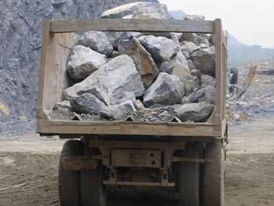 Lorries loaded with stones in a quarry